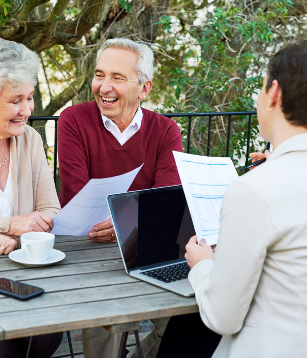 senior couple meeting with their financial planner