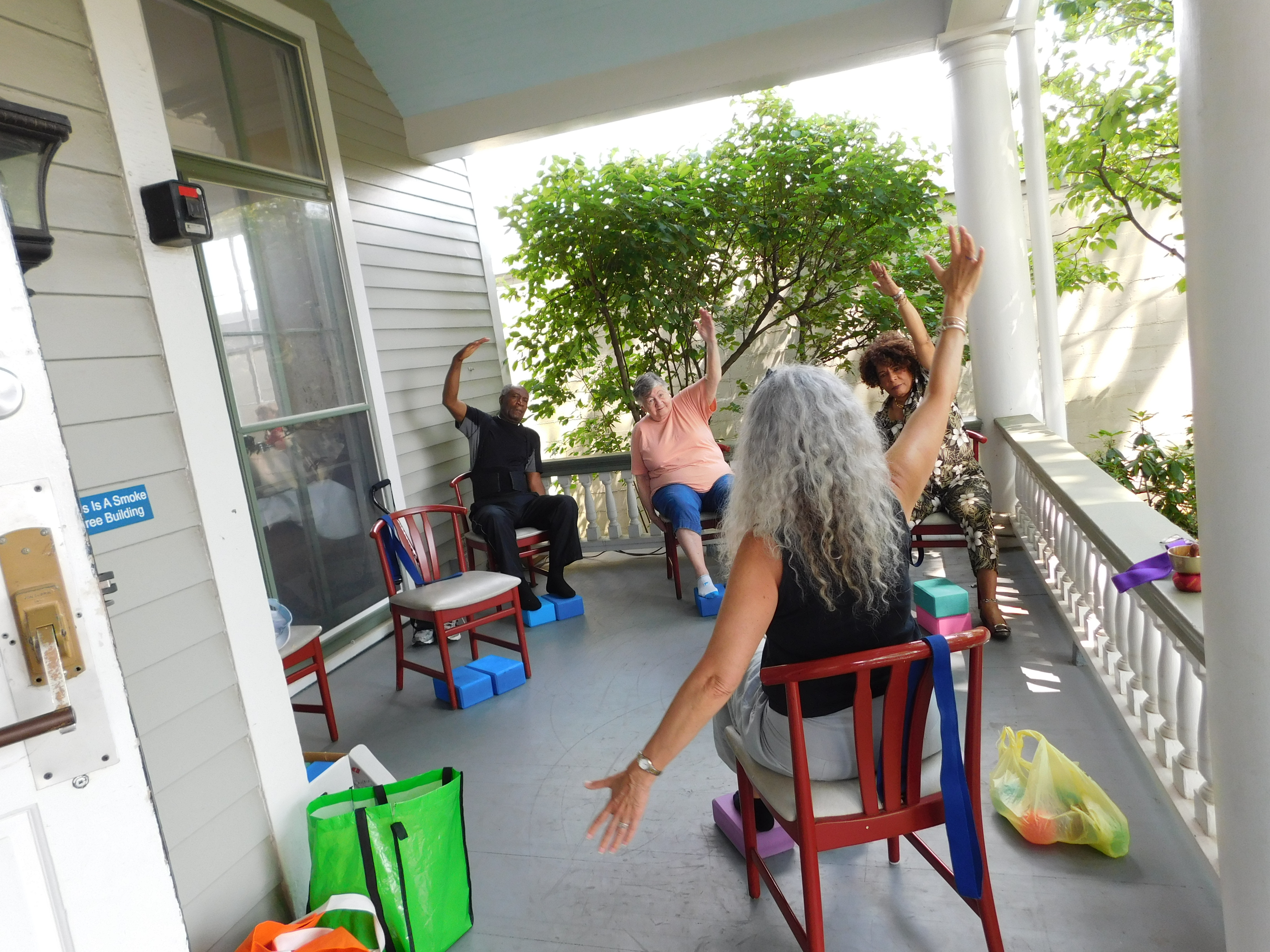 Beautiful weather permits chair yoga on the porch.