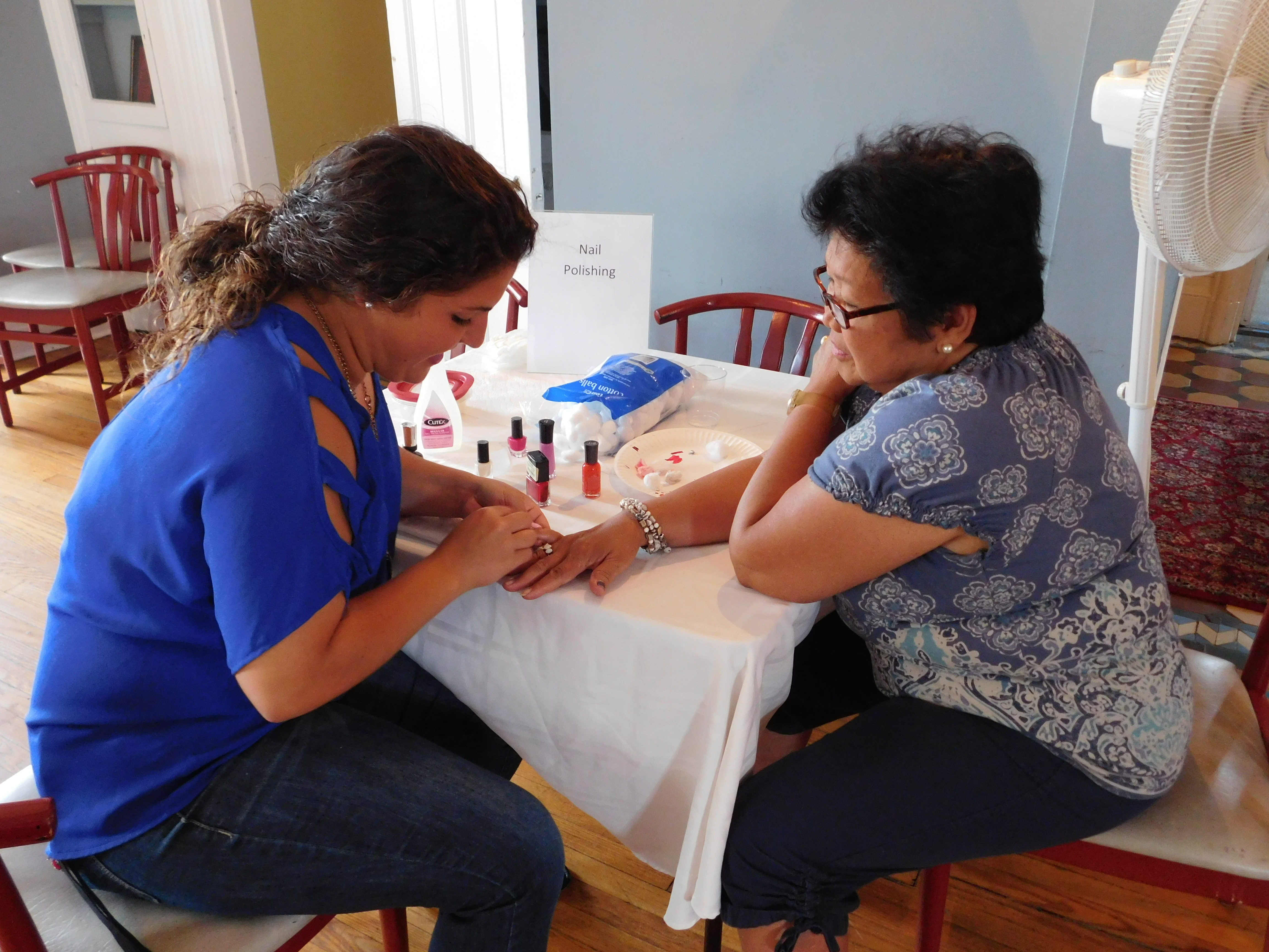 A gentle human touch during a manicure soothes hands and spirit.