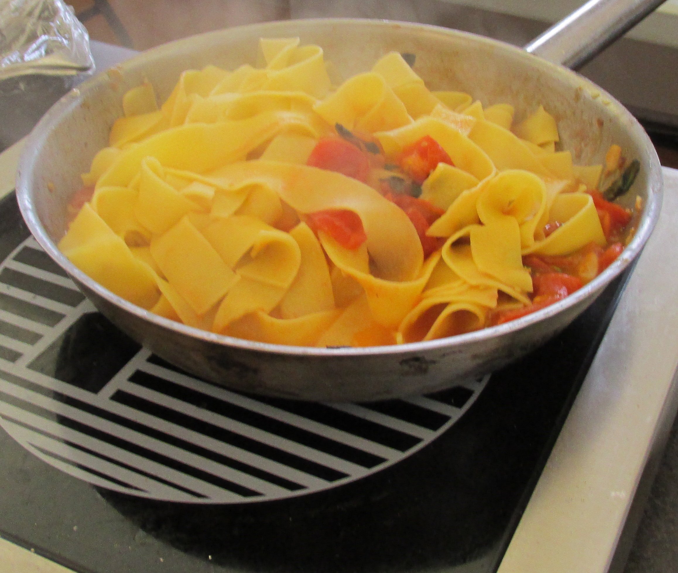 Fresh, homemade pappardelle in red sauce